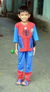 boy in his spiderman outfit and superman sandals