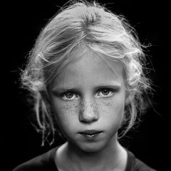 Life's great. Take it seriously. (PascallacsaP) Tags: young girl serious staring portraitphotography portraiture blackandwhite bw acros fujifilm film simulation dark contrast gazing freckles existinglight naturallight availablelight ambientlight noir