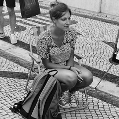 Posing for the caricaturist with a carefull and serious expression (3 €/3 minutes) (pedrosimoes7) Tags: posingforthecaricaturist augustast lisbon portugal people blackandwhite blackwhite street woman girls tourism tourist