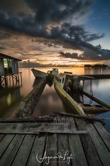 A moody sunset in Sorong, West Papua, Indonesia (angesvdlogt.photography) Tags: landscape dramatic clouds indonesia papua sorong sunken boat moody sunset harbor ngc
