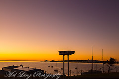 Sunrise over Boston bay Port Lincoln South Australia (Malcom Lang) Tags: sunrise port lincoln south australia australian aussie southaustralia southern southernaustralia southerneyrepeninsula southernocean boats masts ocean water sea solar panels morning ripples lights city trees bulk loader jetty warf sky orange yellow canoneos6d canon canon6d canonef2470mm canonef malcomlang mal lang photography mallangphotography travel visit outdoors outdoor outside saltwater