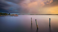 Stormy southern sky. (Jill Bazeley) Tags: smooth reflection app long exposure indian river lagoon intracoastal waterway icw brevard county merritt island florida usa pier piling dock damage hurricane speedboat pleasure boat storm thunderstorm sunset sony a6300 1018mm