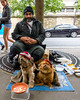 DSC_0961wm (D A Baker) Tags: care homeless eyes squinting trained behaved well faces funny paris france panhandler pet owner dogs little red hats euros change street sidewalk begger fuzzy furry