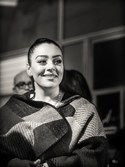airport.candid (grizzleur) Tags: airport beautiful candid girl light portrait smile street streetphotography streetportrait streetcandid omdstreetphotography omd woman beauty soft night nightshot bw mono monochrome poncho olympusomdem10mkii olympus olympusm45mmf18