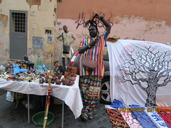 The Africans (RubyGoes) Tags: trastevere lazio rome italy owls car fabric carvings wall street red green yellow stripes