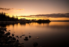 Sunset (Karen_Chappell) Tags: sunset orange water pond nfld newfoundland longexposure nd110 black silhouette paddyspond avalonpeninsula canada atlanticcanada sky evening clouds reflection reflections rocks canonefs1022mm wideangle