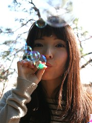 Rise Up (emotiroi auranaut) Tags: girl woman lady blow bubbles blowing bubble peace rise rising portrait pretty attractive beauty beautiful sky sunny message peaceful