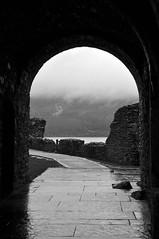 Urquart Arch (magaroonie) Tags: arch urquartcastle 7daysofshooting week9 arainyday blackandwhitewednesday