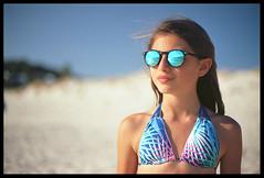 with the sea in the eyes (ukke2011) Tags: nikonf5 nikkorafs5014g kodakektar100 film pellicola 135 analog analogico portrait ritratto beach spiaggia sunglasses sea mare