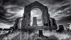 The tower in the window (David Feuerhelm) Tags: monochrome blackandwhite bw noiretblanc schwarzundweisss contrast sky old building tower church window clouds wideangle sigma1020mm nikkor covehithe historic norfolk england nikon d90 infrared silverefex elitegalleryaoi bestcapturesaoi aoi