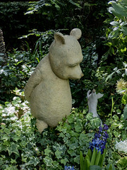 What day is it? (Steve Taylor (Photography)) Tags: winniethepooh pooh piglet bear animal sculpture green brown blue metal bronze asia city singapore plant bush foliage flower ivy flowerdome gardensbythebay