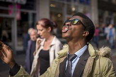 Praise Be... (Leanne Boulton) Tags: people portrait urban street candid portraiture closeup streetphotography candidstreetphotography candidportrait streetportrait streetlife man male face facial expression look emotion feeling mood singing gesture sunglasses prayer praise religion tone texture detail depthoffield bokeh naturallight outdoor light shade shadow sunlight city scene human life living humanity society culture canon canon5d 5dmkiii 70mm character ef2470mmf28liiusm color colour glasgow scotland uk