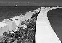La mer (Duevel) Tags: sea water zee kust coast fz2000 haven pier dijk blackwhite landscape seascape