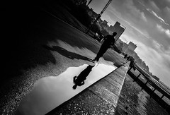 Puddle Running (creativegaz) Tags: bw blackandwhite bnw black beach run reflection reflect water wet walk walking weather people perspective person portrait jog jogging mono nikon nocolour noir d810 dof drama dark puddle
