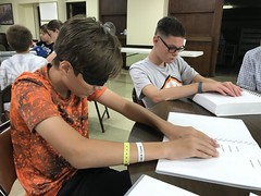 "Photo 3: Participant wearing learning shades reading with a peer • <a style=""font-size:0.8em;"" href=""http://www.flickr.com/photos/29389111@N07/36410832833/"" target=""_blank"">View on Flickr</a>"