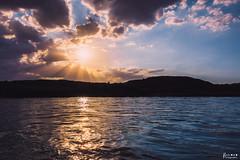 Into the Sun (rvraddict@att.net) Tags: river sunset clouds sunrays golden hour goldenhour water float