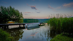 S E R E N I T Y (SpectrumLight) Tags: lake summer summertime holidays vacations travel water landscape boat moon evening dusk reflections tranquil ambience waterscape sonyilce7m2 sonya7ii fe1635mmf4zaoss wideangle sony serenity reeds explore