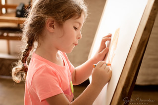 Portrait of a little girl draws