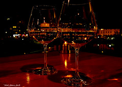 For Two (that_damn_duck) Tags: wineglasses table nighttime romantic romance skyline