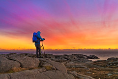 Shooting Sunsets (Ranveig Marie Photography) Tags: pink night evening sunset photographer photographing blue backpack ryggsekk fotosekk rucksack solnedgang solnedgong sky colorful colourful eigerøy egersund eigersund dalane rogaland sea ocean norge norway man person people fotograf standing scenery landscape