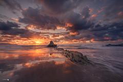 Rain Sky (Caramad) Tags: mar landscape sunset marcantábrico puestadesol rocks agua longexposure sopelana sea bizkaia lluvia clouds seascape rocas atxabiribil olas playa