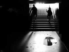 what do you find to my hair (René Mollet) Tags: hair underground unterführung passage silhouette shadow puddle reflection upstairs stairs aarau street streetphotography streetart urban urbanstreet blackandwhite bw renémollet frinds sunrise backlight
