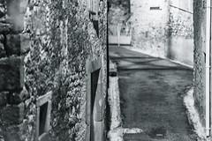 Alley (x1klima) Tags: villespassans occitanie frankreich fr sonya7r ilce7r sony sonyfe85mmf14gm sel85f14gm monochrome schwarzweis noiretblanc bw plain blackandwhite alley streetphotography streets streetview candid urbanity urban abandonment lostplace verlassen verfall desertedness desolateness bereavement desertion decay zerfall verwesung fäulnis zersetzung niedergang dilapidation baufälligkeit verkommenheit schäbigkeit expiry decline lapse disrepair expire beforfeited deteriorate achitectural architecture architektur building buildings