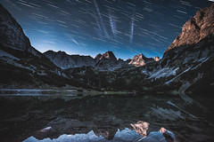 Startrails and mountains! (kevingomes1) Tags: sky lake mountains water reflection travel blue night outdoor outside summer beautiful moon stars austria mountain peak alps moonshine hiking moonlight exploring alpine startrails alp alpenglow nightsky mountainscape alpen