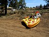 pondering on pizza (citymaus) Tags: oregon eclipse gathering 2017 big summit ochoco national forest or symbiosis musicfestival music art arts festival pondering guy wondering lost thought pizza floatie pool unicorn sitting side road prairie