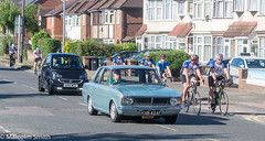 The Mark II And The Cyclists (M C Smith) Tags: ford cortina mk ii car cyclists road pavement houses grass green pentax k3ii bushes parking lamps signs shadows trees lines black blue