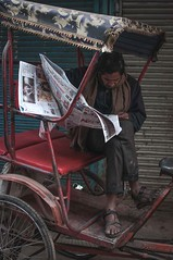 Reading the news... (Syahrel Azha Hashim) Tags: portrait nikon news street profession shallow holiday pc9 simple editorial indian details portraiture india local tricycle dof expression people market streetmarket asia scene humaninterest oneperson olddelhi newspaper colorimage vacation 35mm prime light streetscene naturallight moment colorful streetphotography d300s travel syahrel male handheld colors getaway reading 2015 rajasthan detail