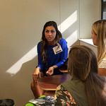 An alumna talking with students at a Professional Networking Symposium