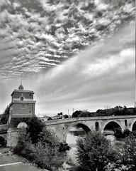 Ponte nuvoloso (ioriogiovanni10) Tags: seguimi monotone monocromatico bew blackewhite biancoenero mark passeggiata fotografia lungotevere bridge tevere river ponte settembre città roma cielo nuvole sky rome pontemilvio canon