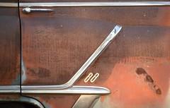 88 (David Sebben) Tags: oldsmobile fourdoor sedan automobile chrome stainless rust patina age