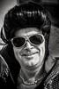 Elvis - leaving the building (Andy J Newman) Tags: blackandwhite white black cape convention d500 elvis glasses nikon porthcawl portrait shades silverefex strret wig wales unitedkingdom gb