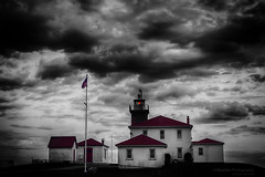 Watchhill Light House, Westerly Rhode Island (Skyelyte) Tags: lighthouse westerlyrhodeisland sky building commissionedbythomasjefferson nightphotography afterdark monochrome selectivecolor clouds dramaticclouds seaside shore shoreline flag historicbuilding historiclighthouse architecture watchtower beacon newengland thomasjefferson red redroof light