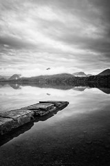 a tranquil isthmus bay (akh1981) Tags: manfrotto mountains moody mono mist cumbria nikon nisi landscape sunrise lakedistrict lake outdoors rocks travel tranquil wideangle water walking calm clouds catbells
