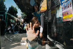 Jerusalem (f.d. walker) Tags: jerusalem israel palestine africa middleeast holy land religion religions religious reflection reflections hand hands gesture woman boy child children jewish judaism orthodox ultraorthodox busstop bus stop streetphotography street sunlight shadow sun strange surreal candidphotography candid color colorphotography clothes city glass layers