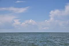 Waterline (Bad Alley (Cat)) Tags: water sky horizon lake lakewinnipeg clouds blue