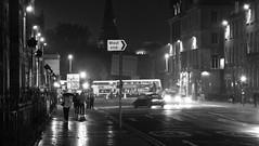 wet night in the New Town (byronv2) Tags: blackandwhite blackwhite bw monochrome noir wet rain weather night nuit nacht westend charlottesquare edinburgh edimbourg scotland street candid bus road pavement reflection umbrellas umbrella perspective