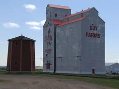 Kenaston SK Guy Farms 20170714_132930 (CanadaGood) Tags: canada saskatchewan sk kenaston agriculture grainelevator building prairie cameraphone 2017 thisdecade canadagood colour color blue red watertower