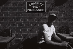 Commit No Nuisance (OzGFK) Tags: australia melbourne victoria city cbd unionelectric commitnonuisance people man blackandwhite monochrome bw urban streetphotography contrast bar summer