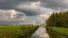 Clouds and Sunlight (BraCom (Bram)) Tags: bracom cloud wolk reflection spiegeling reed riet ditch sloot tree boom farm boerderij polder shower bui afternoon middag wateroverlast flooding grass akker field gras dirksland goereeoverflakkee zuidholland nederland southholland netherlands holland 169 widescreen bramvanbroekhoven nl