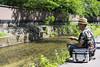 Catching small fish (Eric Flexyourhead) Tags: higashiyama higashiyamaku 東山区 kyoto 京都市 kansai 関西地方 japan 日本 city urban streetphotography japanese guy man fisherman fishing river stream sonyalphaa7 zeisssonnartfe55mmf18za zeiss 55mmf18