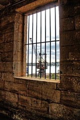 From behind bars. (Ian Ramsay Photographics) Tags: convict precinct cockatooisland sydney newsouthwales australia behind bars