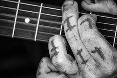 Live life (RaminN) Tags: oregon portland performer street tattoo fingers strings guitar