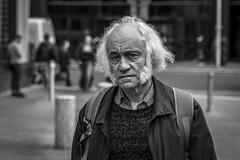 Mutton Chops (Leanne Boulton) Tags: portrait people urban street candid portraiture closeup streetphotography candidstreetphotography candidportrait streetportrait eyecontact candideyecontact streetlife old aged elderly man male face facial expression look emotion feeling mood eyes atmosphere style stylish fashion hairstyle sideburns sideboards muttonchops chops retro tone texture detail depthoffield bokeh naturallight outdoor light shade shadow city scene human life living humanity society culture canon canon5d 5dmkiii 70mm character ef2470mmf28liiusm black white blackwhite bw mono blackandwhite monochrome glasgow scotland uk