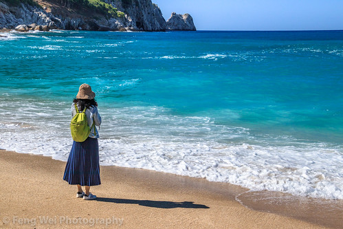Female Tourist Walking Along Mediterranean Coast, Kleopatra Beach, Alanya, Antalya, Turkey