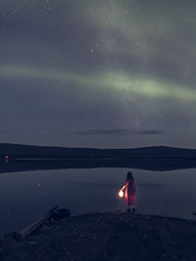 Leaving (AngryTheInch42) Tags: auroraborealis northernlights milkyway stars kiruna water reflections woman lantern astrophotography