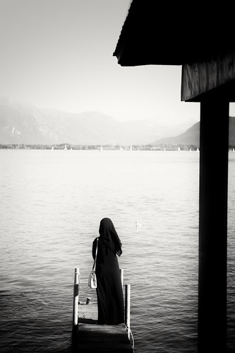 Woman in a burkha by the lake